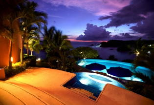 Beautiful nighttime view of sunset and pool.