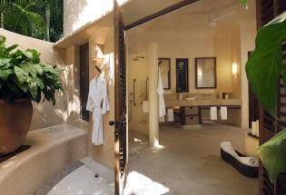 Guest bathroom with outside shower.