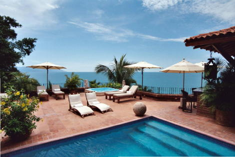 Looking from pool bedroom across poll and spacious terrace to view of Banderas Bay.