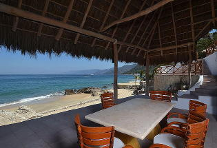 Large Palapa covered terrace at beach level.