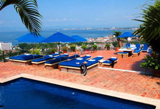 View from pool and sundeck overlooking city of Puerto Vallarta.